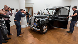 "© Licensed to London News Pictures. 12/08/2016. London, UK. Media photograph John Lennon's iconic 1956 Austin Princess Limousine Hearse, immortalised in John Lennon and Yoko Ono's 1972 film ""Imagine"" (est. GBP 250,000) at the photocall for classic cars at Sotheby's, New Bond Street, ahead of their auction on 7 September in Battersea Park. Photo credit : Stephen Chung/LNP"