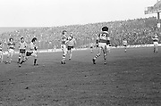 Kerry gains possession while Dublin runs up behind him during the All Ireland Senior Gaelic Football Semi Final, Dublin v Kerry in Croke Park on the 23rd of January 1977. Dublin 3-12 Kerry 1-13.