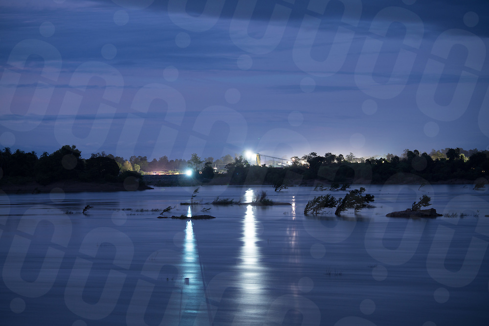 Dec 15, 2016 - Preah Rumkel (Cambodia). Floodlights across the Mekong river, the paticular stretch of area near the Laos-Cambodia border was once the protected home of the Mekong Irrawaddy dolphins. The cacophony of noise from daily explosives used by workers building the Don Sahong dam has forced the dolphins into unprotected waters. © Thomas Cristofoletti / Ruom