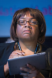 © London News Pictures. FILE PIC 23/09/2013 . . MP for DIANE ABBOTT MP , on her iPad in the audience duringDay 2 of the Labour Party 's annual conference in Brighton . Reports have suggested that Diane Abbott might be promoted to the shadow cabinet in the weeks expected reshuffle. Photo credit : Joel Goodman/LNP