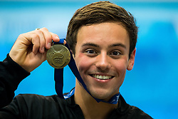 Tom Daley from Dive London Aquatics Club poses with his Gold medal after winning the Mens 10m Platform Final - Mandatory byline: Rogan Thomson/JMP - 24/01/2016 - DIVING - Southend Swimming & Diving Centre - Southend-on-Sea, England - British National Diving Cup Day 3.