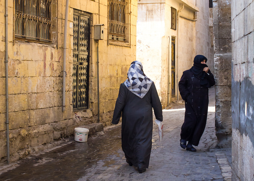 Muslim women in an alley of the old city of Urfa, or Sanliurfa, in southeastern Turkey.<br /> <br /> Licensed by Tandem Stills + Motion. Available here: https://tandemstock.com/assets/86258839