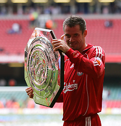 CARDIFF, WALES - SUNDAY, AUGUST 13th, 2006: Liverpool's Jamie Carragher lifts up the trophy after beating 2-1 Chelsea in the Community Shield match at the Millennium Stadium. (Pic by David Rawcliffe/Propaganda)