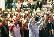 The congregation joins in song after prayer for the victims of the shooting in Tucson yesterday at the Pantano Christian Church in East Tucson, Arizona January 9, 2011.  The pastor also prayed for the shooter in the case.  REUTERS/Rick Wilking (UNITED STATES)