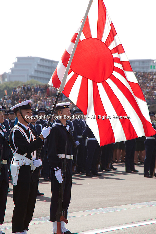 October, 23, 2016, Asaka, Saitama Prefecture, Japan: Members of the Japan Maritime Self Defense Force flaunt their colors during an annual military review held at the Asaka Training Area, a Japan Ground Self Defense Force (JSDF) base on the outskirts of Tokyo. For this event, Prime Minister Shinzo Abe, top ranking Japanese brass and international dignitaries were in attendance to view Japan's military might. This included 4000 troops, 27 divisions, 280 vehicles and artillery, plus 50 aircraft of the Ground, Air, and Maritime branches of the JSDF. (Torin Boyd/Polaris).