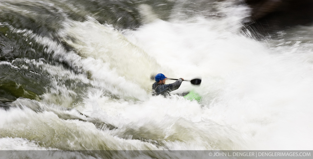 """An unidentified whitewater kayaker powers their kayak through the rapids at """"Sweet's Falls"""" on the Gauley River during American Whitewater's Gauley Fest weekend. The upper Gauley, located in the Gauley River National Recreation Area is considered one of premier whitewater rivers in the country."""