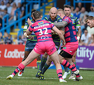 Jordan Baldwinson (L) &amp; Andy Bostock (R) of Featherstone Rovers tackle Keith Galloway of Leeds Rhinos during the Super 8s Qualifiers match at The Big Fellas Stadium, Post Office Road, Pontefract.<br /> Picture by Richard Land/Focus Images Ltd +44 7713 507003<br /> 06/08/2016