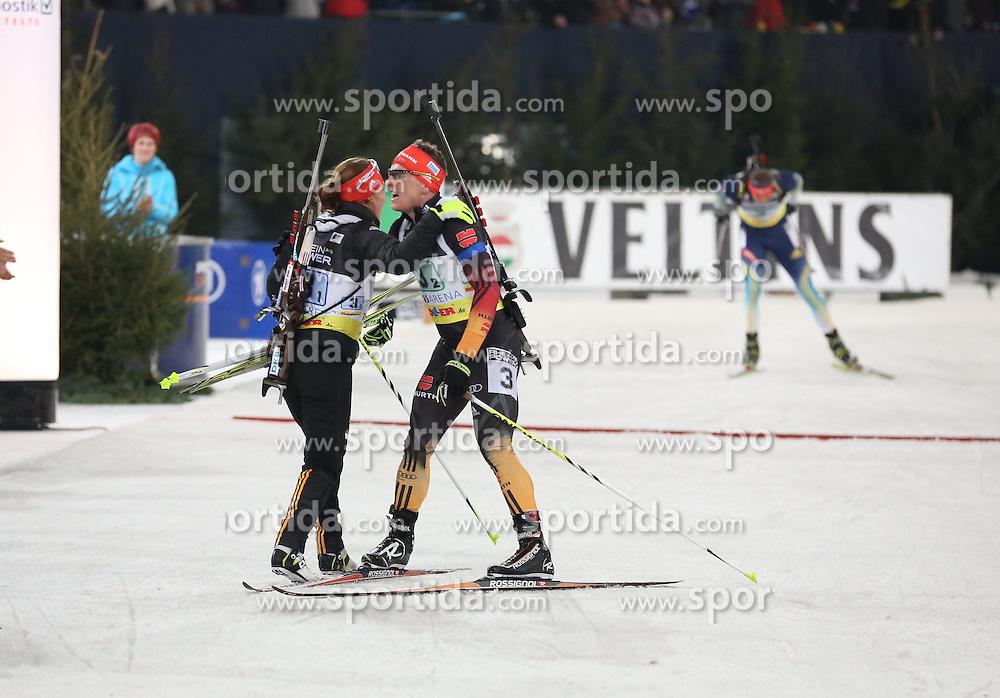 28.12.2013, Veltins Arena, Gelsenkirchen, GER, IBU Biathlon, Biathlon World Team Challenge 2013, im Bild Laura Dahlmeier (Deutschland / Germany), Florian Graf (Deutschland / Germany) jubeln beim Zieleinlauf, freuen sich, celebrating their victory, Emtotion, Freude, Glueck, Luck // during the IBU Biathlon World Team Challenge 2013 at the Veltins Arena in Gelsenkirchen, Germany on 2013/12/28. EXPA Pictures &copy; 2013, PhotoCredit: EXPA/ Eibner-Pressefoto/ Schueler<br /> <br /> *****ATTENTION - OUT of GER*****