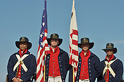 Niantic, Connecticut, July 6, 2012 - The honor guard from left to right: US Coast Guard Seaman Azaert Rivera, Seaman Jon Waldrop, Seaman Elliott Gray and Seaman Ryan Gordon dressed in 1812 period attire as they would have worn in the Revenue Cutter Service, the predecessor to the present day Coast Guard, present the Colors for The OpSail Committee. The seamen are stationed in Washington, D.C.