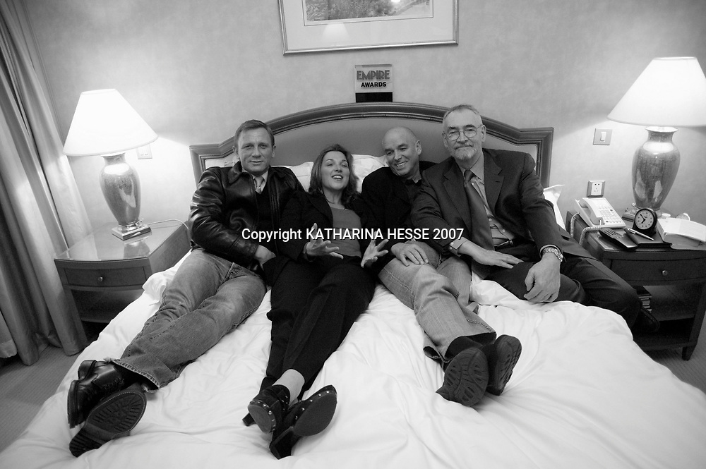 BEIJING, JANUARY-29: Casino Royale's team in a hotel room before the premiere in Beijing : ( from L to R)..Daniel Craig, producer Barbara Broccoli, director Martin Campbell and co-producer Michael Wilson.