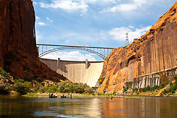 Glen Canyon, Arizona: A fishing expedition begins on the Colorado River running south through Glen Canyon, below the Glen Canyon Dam.   Additional views, both horizontal and vertical, with different horizon placements available.