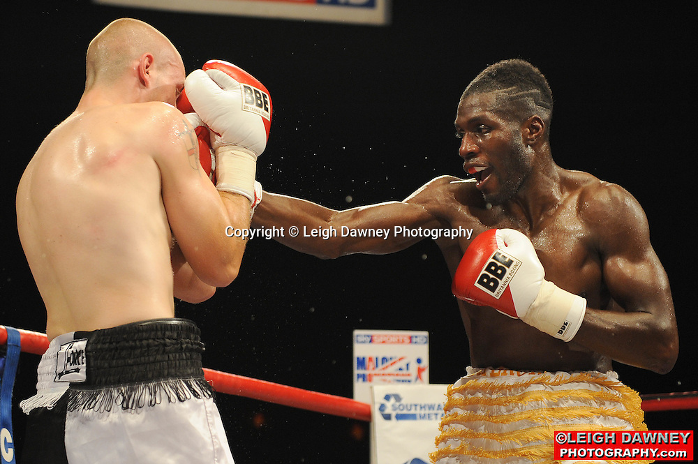 Menay Edwards (yellow shorts) defeats Carl Wild at the Brentwood Centre on 25th June 2010.Frank Maloney Promotions. Photo credit: © Leigh Dawney