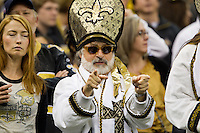 28 November 2011: A Saints fan dressed like the Pope cheers for the New Orleans Saints during the Saints 49-24 victory over the Giants at the Mercedes-Benz Superdome in New Orleans, LA.