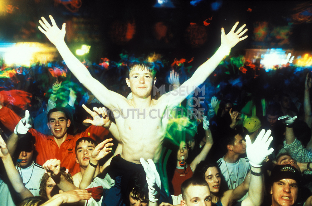 Teenager with his arms spread wide, Clockwork Orange, Camden, London, 1995