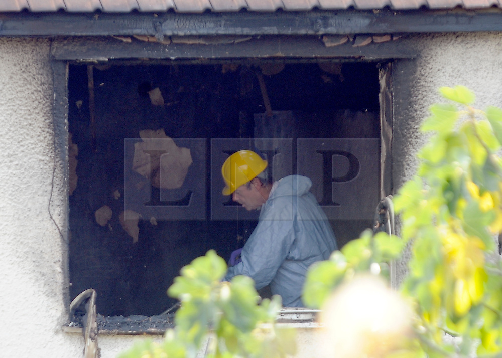 © Licensed to London News Pictures. 23/09/2011. LONDON, UK. An investigator in an upstairs window. Six people, including three children, two teenagers and an adult have died following a house fire in Neasden, North West London today (24 Sept 2011). Emergency services were called tot he blaze in the early hours of the morning. Photo credit:  Stephen Simpson/LNP
