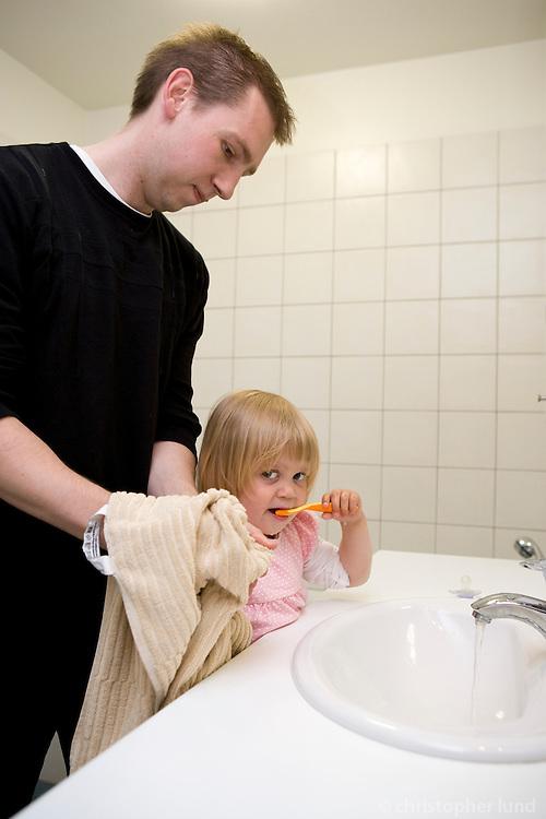 Hörður Jóhannsson (31) getting hid daughter Bjarney (3) ready for bed.