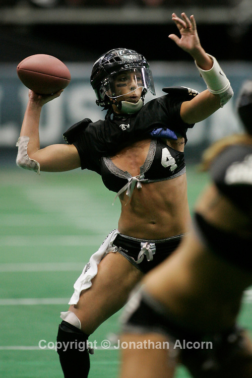 Nov 28, 2009 - Los Angeles, California, USA - A quarterback for the Los Angeles Temptation team in the  Lingerie Football League throws a pass. The Lingerie Football League features some of America's most beautiful and athletic women playing 7-on-7 full-contact tackle football on Friday nights at major arenas and stadiums, as part of LFL, Friday Night Football.