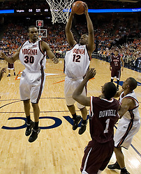 Virginia Cavaliers forward Jamil Tucker (12)  grabs a rebound against VT.  The Virginia Cavaliers Men's Basketball Team defeated the Virginia Tech Hokies 69-56 at the John Paul Jones Arena in Charlottesville, VA on March 1, 2007.