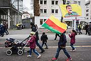 Frankfurt | 18 March 2017<br /> <br /> Am Samstag (18.02.2017) feierten &uuml;ber 30000 Kurden im Rahmen einer Demonstration das kurdische Neujahrsfest Newroz, bei der Demo sprachen sie sich gegen eine Diktatur und f&uuml;r die Freilassung von PKK-F&uuml;hrer Abdullah &Ouml;calan aus.<br /> Hier: Eine Familie mit Kinderwagen und kleinen Kindern tragen bei der Demo eine kurdische Fahne in den Farben gelb-rot-gr&uuml;n und eine Fahne mit einem Foto von &Ouml;calan und der Aufschrift &quot;Freedom For &Ouml;calan&quot;.<br /> <br /> photo &copy; peter-juelich.com<br /> <br /> Nutzung honorarpflichtig!