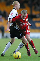 Photo: Paul Thomas.<br /> Port Vale v Bristol City. Coca Cola League 1. 17/12/2005.<br /> <br /> Bristol's Dave Cotterill tries to get past Nathan Lowndes.