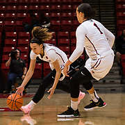 24 February 2018: The San Diego State women's basketball team closes out it's home schedule of the regular season Saturday afternoon against San Jose State. San Diego State Aztecs guard Naje Murray (10) picks up a loose ball after the Aztecs defense poked it away from San Jose State. At halftime the Aztecs lead the Spartans 36-33 at Viejas Arena.<br /> More game action at sdsuaztecphotos.com