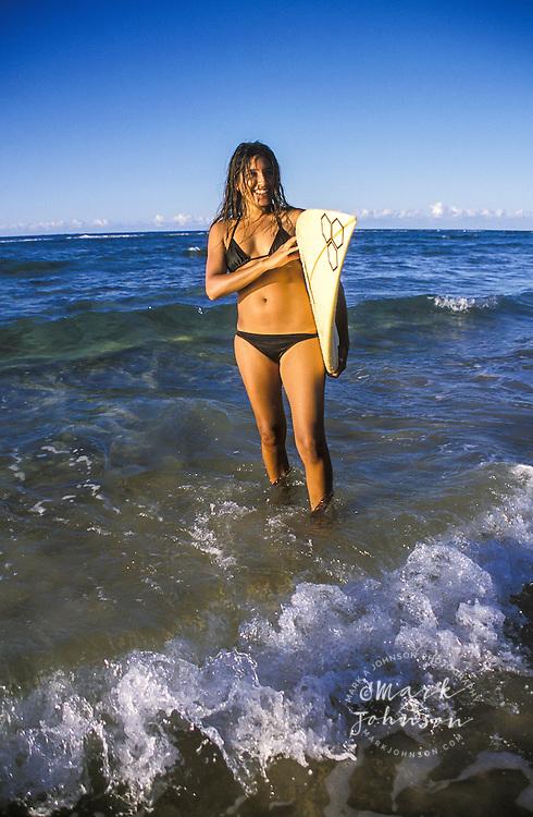Australia, Queensland, N. Stradbroke Island, female surfer portrait.  MR available