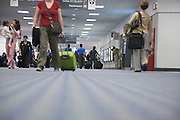 airport hall with passenger walking from and to there arrival and departing gate in an airport terminal