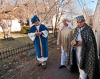 Three Wise Men Leon Albushies, George Hetherington and Carl Gebhardt walk down the street in Gilford Village following the Living Nativity scene presented at the Thompson Ames Historical Society Sunday afternoon.  (Karen Bobotas/for the Laconia Daily Sun)