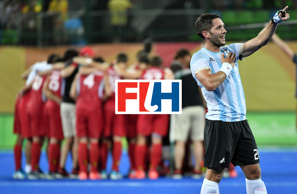 Argentina's Agustin Mazzilli acknowledges fans after winning the men's Gold medal field hockey Belgium vs Argentina match of the Rio 2016 Olympics Games at the Olympic Hockey Centre in Rio de Janeiro on August 18, 2016. / AFP / Pascal GUYOT        (Photo credit should read PASCAL GUYOT/AFP/Getty Images)