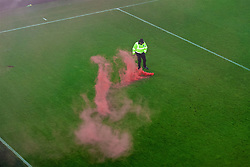 LIVERPOOL, ENGLAND - Monday, December 19, 2016: An Everton steward kicks a red smoke bomb off the pitch as supporters celebrate a late injury-time winning goal against Everton during the FA Premier League match, the 227th Merseyside Derby, at Goodison Park. (Pic by Gavin Trafford/Propaganda)
