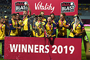 Simon Harmer holds the trophy as Essex wiin the Vitality Blast Trophy during the Vitality T20 Finals Day 2019 match between Worcestershire County Cricket Club and Essex County Cricket Club at Edgbaston, Birmingham, United Kingdom on 21 September 2019.