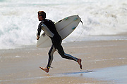 MANHATTAN BEACH, CALIFORNIA, USA – JUNE 20, 2013. Surfers at El Porto beach at the beginning of summer on June 20, 2013. El Porto is popular because an underwater canyon creates large waves.