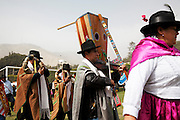 A procession of dancers and muscicians, this one playing a traditional Peruvian harp, parade through a town just outside the capital Lima. Every July 28th Peru erupts in celebration, celebrating their independence from the Spanish. The war for independence began in 1811 and after 10 years of conflict in 1821, led by the national hero José de San Martín, an Argentine General and one of the main leaders of South American independence movement, they finally won. Fiestas Patrias Peruanas, or Peruvian National Holidays, sees Peruvians returning home to spend time with their families and extravagant processions through most Peruvian towns.