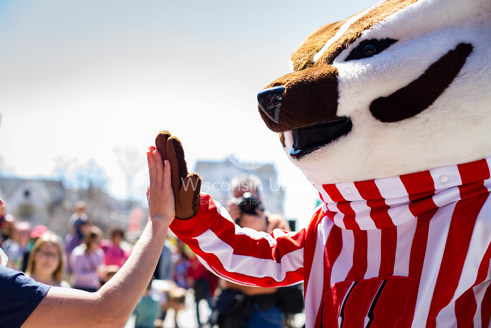 A student high fives Bucky Badger at the Union South 5th Anniversary celebration on April 14, 2016.