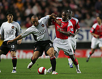 Photo: Lee Earle.<br /> Charlton Athletic v Manchester United. The Barclays Premiership. 23/08/2006. United's Mikael Silvestre (L) battles with Darren Bent.