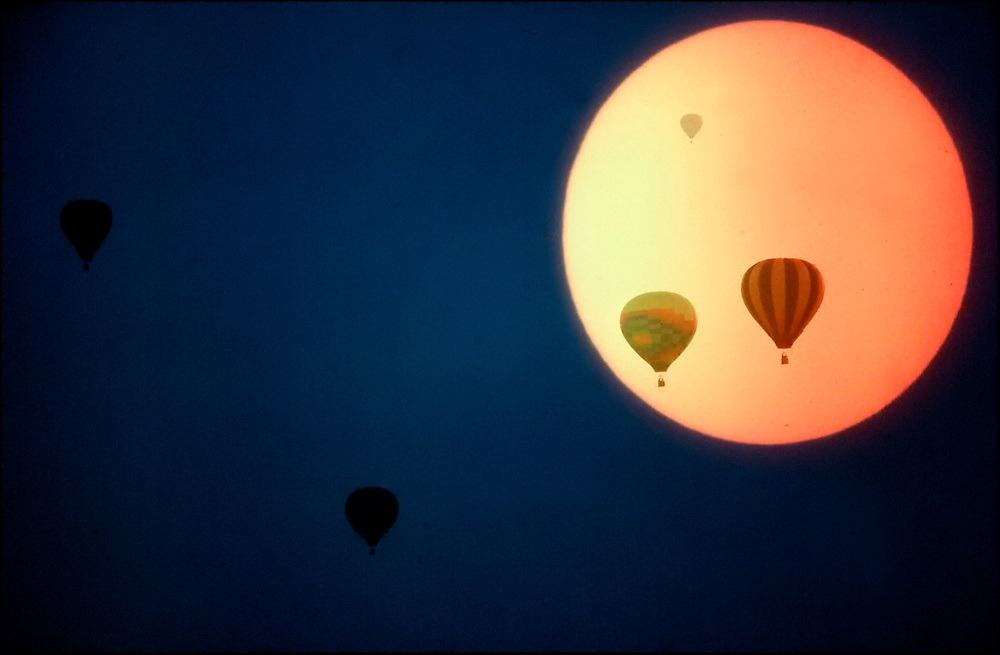 illustration of hot air balloons against the sun..©Ed Hille