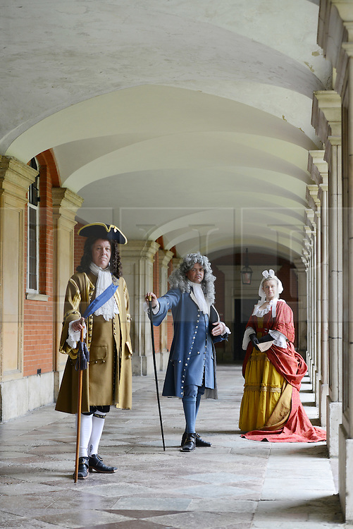 © Licensed to London News Pictures. 01/04/2014. Hampton Court Palace, England. Hampton Court will use actors to represent George I (gold), George II (blue), & Queen Caroline (red) from the Easter holidays to mix with visitors on the 300th anniversary of the Hanovarian accesion. http://www.royalcollection.org.uk/press-release/the-first-georgians-art-monarchy-1714-1760  Photo credit : Mike King/LNP