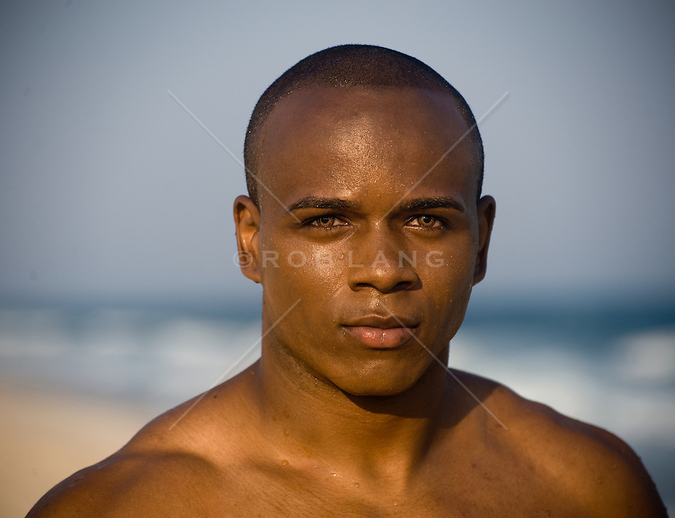 Portrait of young African American with green eyes at the beach