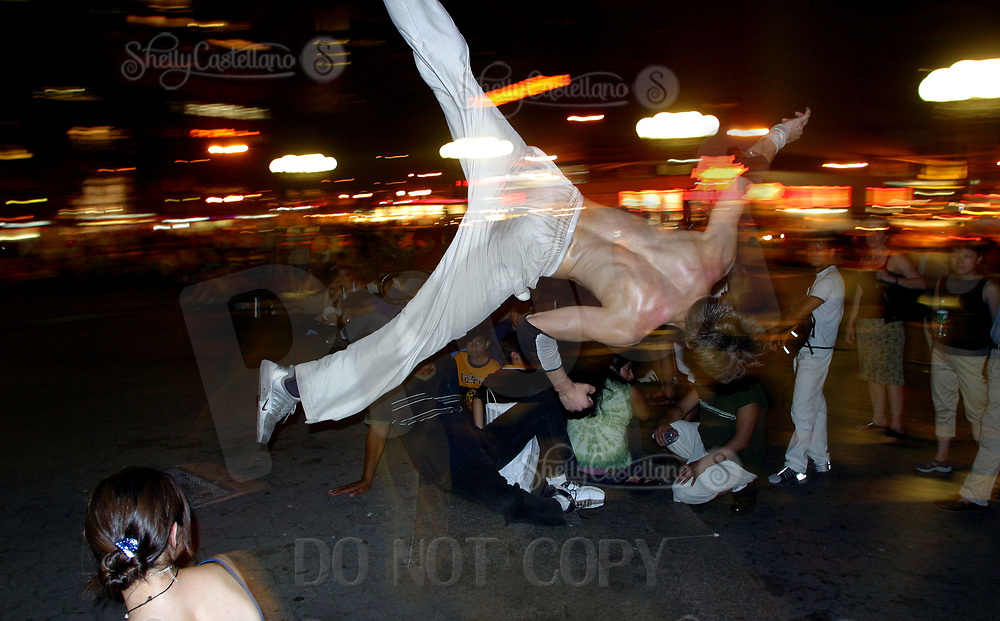 Aug 16, 2002; New York, NY, USA; Union Square is getting back to normal by having its friday night break dancing shows for the public in midtown.  This dancer does a filp down the stairs past the crowd on a hot summer night.  Mandatory Credit: Photo by Shelly Castellano/ZUMA Press. (©) Copyright 2002 by Shelly Castellano