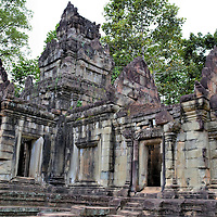 Preah Pithu Group at Angkor Thom in Angkor Archaeological Park, Cambodia<br /> There is a grouping of five, small temples not far from the Terrace of the Leper King called the Preah Pithu Group. Construction of the collection began under King Suryavayman II during the first half of the 12th century. The first four sanctuaries were dedicated to Shiva while the fifth and youngest one is a Buddhist temple.