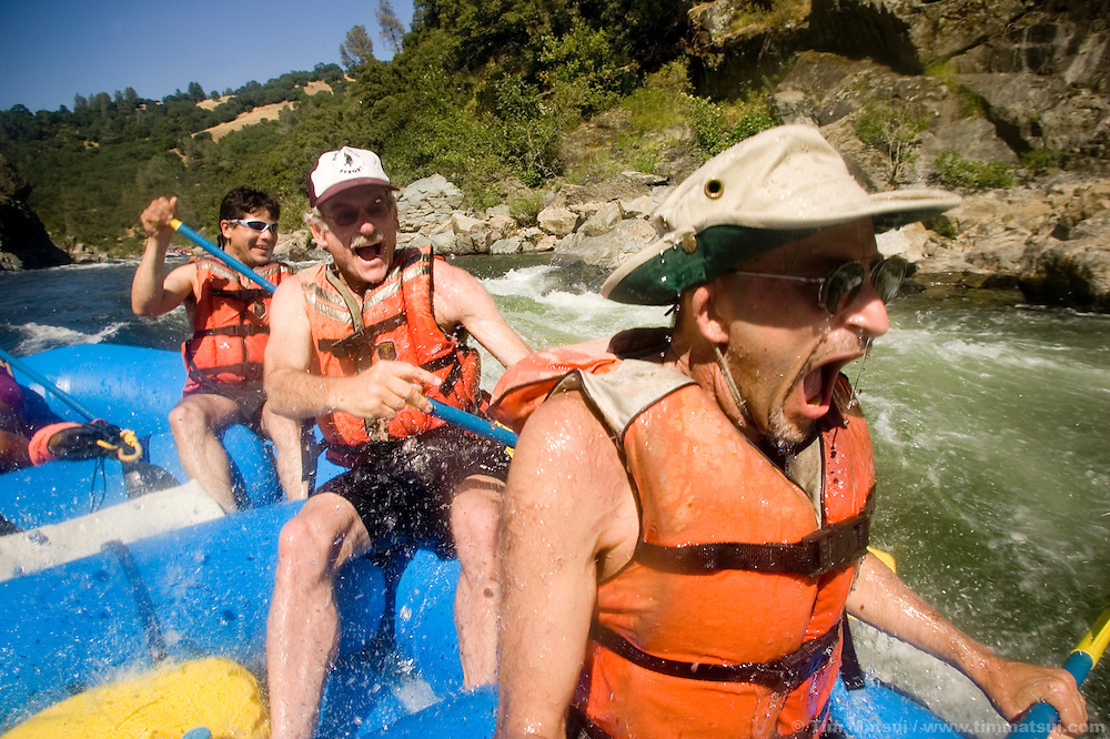 SATURDAY JULY 8, 2006 - LOTUS, CA  Joseph Chase, right, gasps after a thorough dousing of river water while Bill Coppock, center, and Ruben Garcia, left, laugh at the Healing Waters weekend retreat, a non profit whose mission is to empower, inspire and enrich the lives of people challenging HIV/AIDS through wilderness adventures, on Saturday, July 8, 2006 on the South Fork of the American River in Calif. .