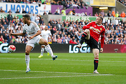 Wayne Rooney of Manchester United controls the ball accross to Juan Mata who scores a goal to make it 0-1 - Mandatory byline: Rogan Thomson/JMP - 07966 386802 - 30/08/2015 - FOOTBALL - Liberty Stadium - Swansea, Wales - Swansea City v Manchester United - Barclays Premier League.