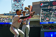 Former Minnesota Twins players Alexi Casilla #12 and J.J. Hardy #2 of the Baltimore Orioles warm up before a game against the Twins on May 12, 2013 at Target Field in Minneapolis, Minnesota.  The Orioles defeated the Twins 6 to 0.  Photo: Ben Krause