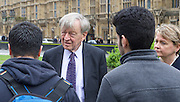 Refugee children and Lord Alf Dubs gather on College Green ahead of <br /> today&rsquo;s vote on amendment to the Immigration Bill (which could see 3,000 unaccompanied refugee children in Europe given sanctuary in the UK).<br /> <br /> The children have been allowed safe passage to the UK to be reunited with family members following action by Citizens UK to enable them to access their legal rights. Under Dublin III regulations, unaccompanied refugee minors in Europe have a legal right to be with their families in the UK whilst their asylum claims are assessed. <br /> <br /> 25th April 2016 <br /> <br /> Lord Dubs with the two refugee boys who are from Darʿā in Syria who arrived in UK via Calais with Yvette Cooper MP <br /> <br /> <br /> Photograph by Elliott Franks <br /> Image licensed to Elliott Franks Photography Services