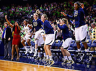 SOUTH BEND, IN - MARCH 04: Members of the Notre Dame Fighting Irish celebrate in the closing minutes against the Connecticut Huskies at Purcel Pavilion on March 4, 2013 in South Bend, Indiana. Notre Dame defeated Connecticut 96-87 in triple overtime to win the Big East regular season title. (Photo by Michael Hickey/Getty Images)