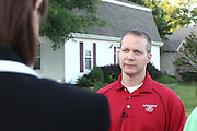 """Battlefield Fire Chief Bryan NewBerry talks with the local media after a suspicious white powder was found in an envelope in a Southwest Missouri woman's mail on May 22, 2012 in Springfield, Missouri. After sustaining a two block quarantine zone from the woman's home for four hours, the """"all clear"""" was given and no threat was found. (David Welker / TurfImages.com)."""