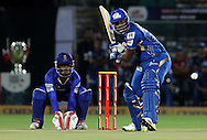 Mumbai Indian player Dwayne Smith plays a shot during match 1 of the Karbonn Smart Champions League T20 (CLT20) 2013  between The Rajasthan Royals and the Mumbai Indians held at the Sawai Mansingh Stadium in Jaipur on the 21st September 2013<br /> <br /> Photo by Vipin Pawar-CLT20-SPORTZPICS <br /> <br /> Use of this image is subject to the terms and conditions as outlined by the CLT20. These terms can be found by following this link:<br /> <br /> http://sportzpics.photoshelter.com/image/I0000NmDchxxGVv4