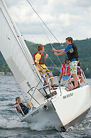 In conjunction with Winnipesaukee Yacht Club's sailing week Lake Winnipesaukee Sailing Association participants Luke Pongratz, Jack Conaton, volunteer Warner Nickerson at the helm and Patrick M. sail back to Smith Cove Wednesday afternoon after their day trip to Bear Island on Lake Winnipesaukee.  (Karen Bobotas/for the Laconia Daily Sun)