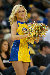 April 10, 2011; Oakland, CA, USA;  A Golden State Warriors cheerleader performs before the game against the Sacramento Kings at Oracle Arena.