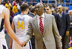 Dec 20, 2016; Morgantown, WV, USA; Radford Highlanders head coach Mike Jones shakes hands with West Virginia Mountaineers players after the game at WVU Coliseum. Mandatory Credit: Ben Queen-USA TODAY Sports